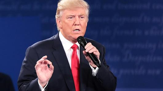 Republican presidential nominee Donald Trump responds to a question during the town hall debate at Washington University on October 9, 2016 in St Louis, Missouri.