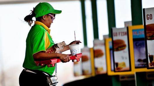 An employee delivers food at a Sonic drive-in restaurant in Normal, Illinois.