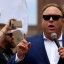 Apple follows Spotify to pull Alex Jones' InfoWars podcasts for 'hate speech'