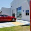 Tesla shares slide a day after announcing store closures, layoffs and a loss for the first quarter