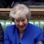 Theresa May's government survives a no-confidence vote after its crushing Brexit defeat