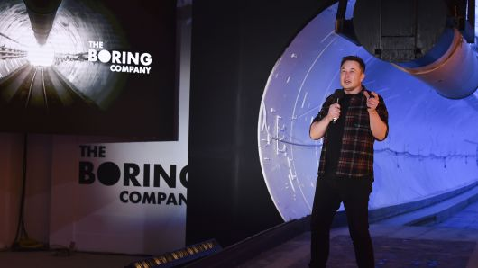 Elon Musk, co-founder and chief executive officer of Tesla Inc., speaks during an unveiling event for the Boring Co. Hawthorne test tunnel in Hawthorne, California, U.S., on Tuesday, Dec. 18, 2018. Musktook the wraps off his Boring Co.'s first completedtesttunnel on Tuesday, with a lot of razzle-dazzle, the admission he had spent $40 million of his own money on the project and a surprise twist in the underlying technology. Photographer: Robyn Beck/Pool via Bloomberg