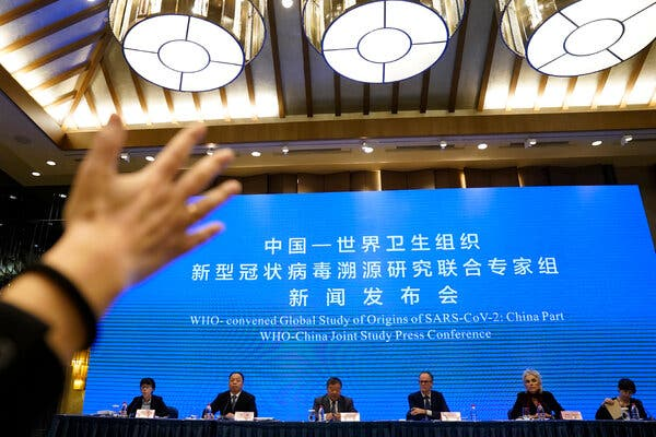 A team of World Health Organization scientists spoke during a news conference in Wuhan, China, on Tuesday.