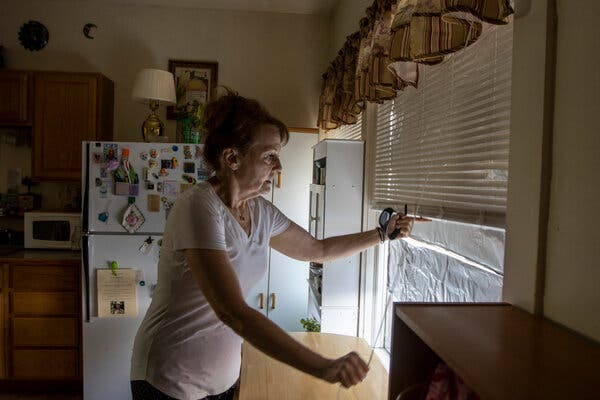 Jane Houst lined a window with tin foil in her Shoshone, Idaho, apartment to repel heat this month.